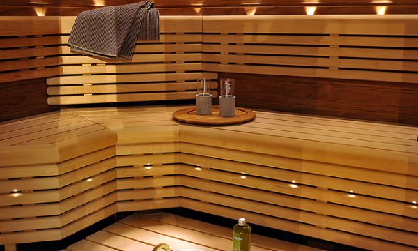 Large Sauna With Wooden Seats and a Towel